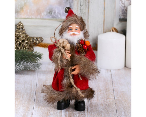 4316753 Дед Мороз в красной шубке с хворостом 16 см